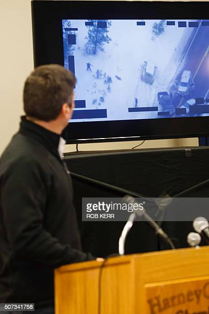 FBI special agent Greg Bretzing looks at a video of the shooting death of Robert LaVoy Finicum as he addresses the public at the Harney County...