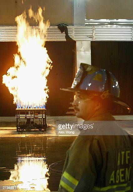 Special agent Greg Hine of the Bureau of Alcohol Tobacco Firearms and Explosives monitors a fire set up by a natural gas burner November 17 2003...