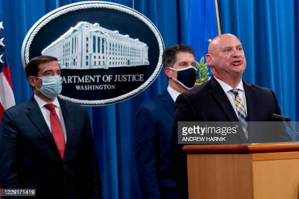 Special Agent in Charge of the Pittsburgh field office Michael Christman, accompanied by Assistant Attorney General for the National Security...