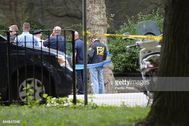 FBI special agent in windbreaker joins NYPD FDNY investigators in Central Park NYPD emergency services FBI FDNY investigators closed off a portion of...