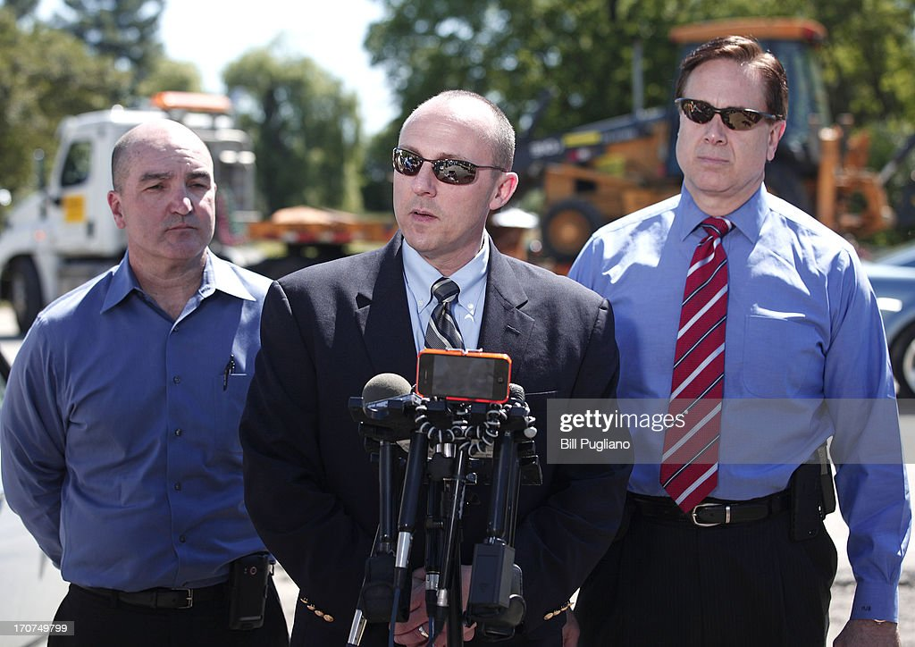 Special Agent Robert D. Foley III (C) speaks to the media while a digging machine (background) arrives at a field outside Detroit where the possible remains of former Teamsters' union president Jimmy Hoffa may be located June 17, 2013 in Oakland Township, Michigan. The agents were acting on a tip provided by Tony Zerilli, 85, a former mobster, who was released from prison in 2008. Hoffa, who had reported ties to organized crime, went missing in July of 1975.