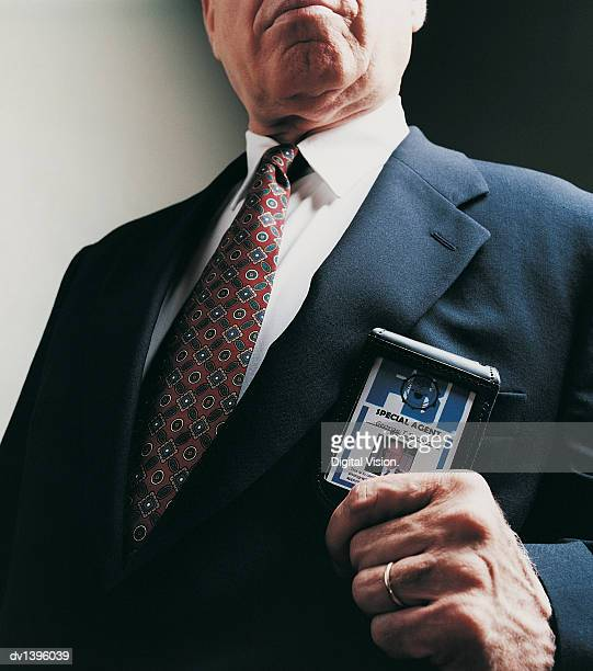 special agent showing his id card - fbi id stock pictures, royalty-free photos & images