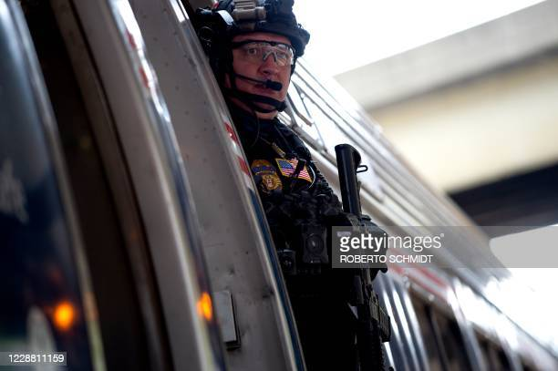 Special agent working for AMTRAK keeps guard aboard a train being used by Democratic presidential nominee Joe Biden at the Pittsburgh train station...