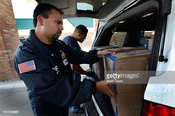 Special agents from Immigration and Customs Enforcement search a vehicle heading into Mexico at the Hidalgo border crossing on May 28, 2010 in...