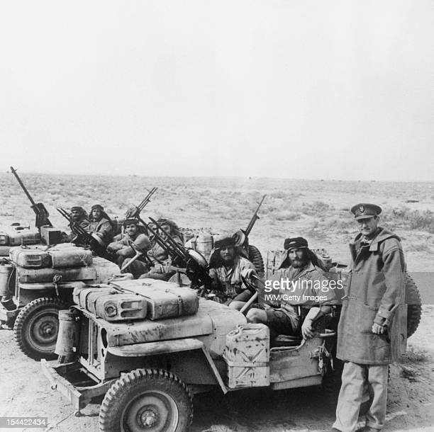 A Special Air Service jeep patrol is greeted by its commander Colonel David Stirling on its return from the desert 18 January 1943