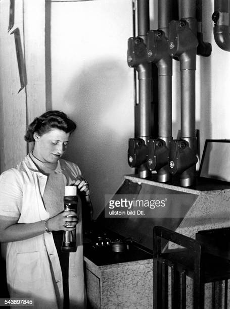 Special announcements are quickly conveyed via pneumatic tube inside aeilmel radio station Photographer Curt Ullmann Published by 'Hier Berlin'...