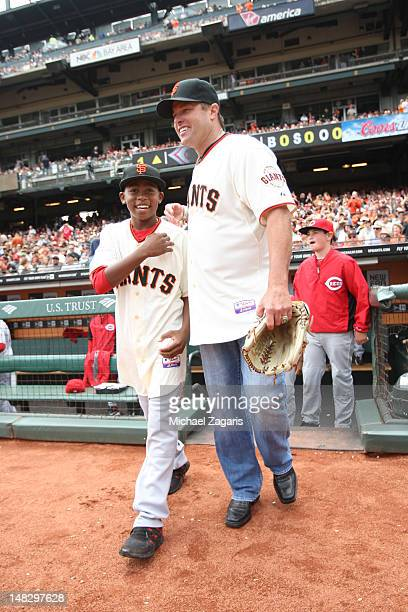 Special Assistant JT Snow of the San Francisco Giants stands with Darren Baker on the field prior to the game against the Cincinnati Red at ATT Park...