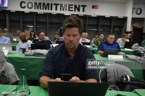 Special Assistant to Baseball Operations Scott Hatteberg of the Oakland Athletics checks his phone in the Athletics Draft Room on the opening day of...