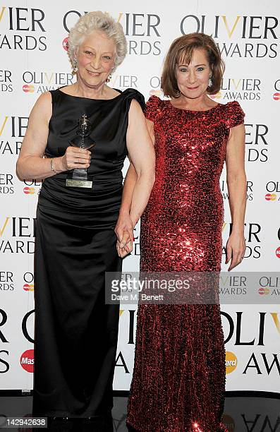 Special Award winner Dame Monica Mason and presenter Zoe Wanamaker pose in the press room at the 2012 Olivier Awards held at The Royal Opera House on...