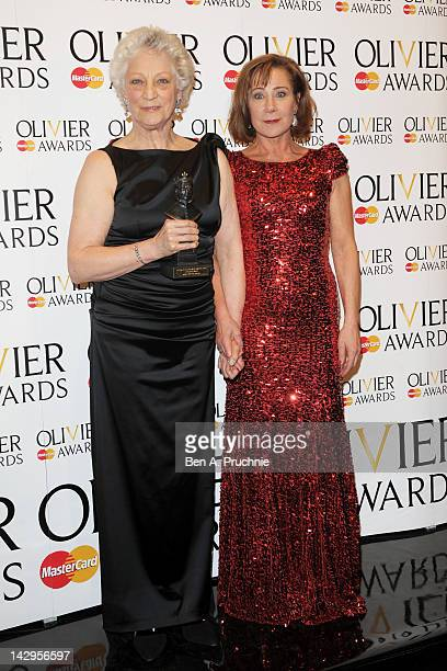 Special Award winner Dame Monica Mason and presenter Zoe Wanamaker pose in the press room during the 2012 Olivier Awards at The Royal Opera House on...