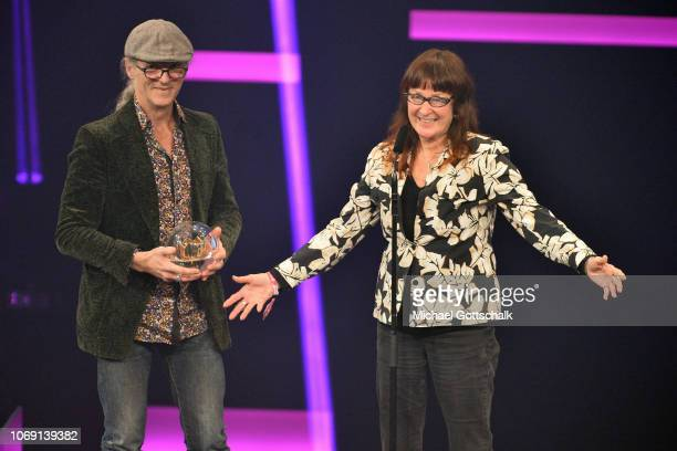 'Special' award winners Birgit Lohmeyer and Horst Lohmeyer from 'Jamel rockt den Förster' Festival speak on stage at the 1Live Krone radio award at...
