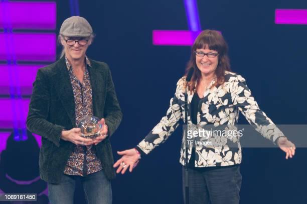'Special' award winners Birgit Lohmeyer and Horst Lohmeyer from 'Jamel rockt den Förster' Festival speak on stage at 1Live Krone radio award at...