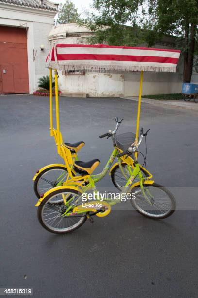special bicycles for multiplayer - liyao xie stock pictures, royalty-free photos & images