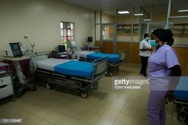 Special care nurse stands in the intensive care unit of the isolation ward set up with an initial five beds with ventilators in readiness for...