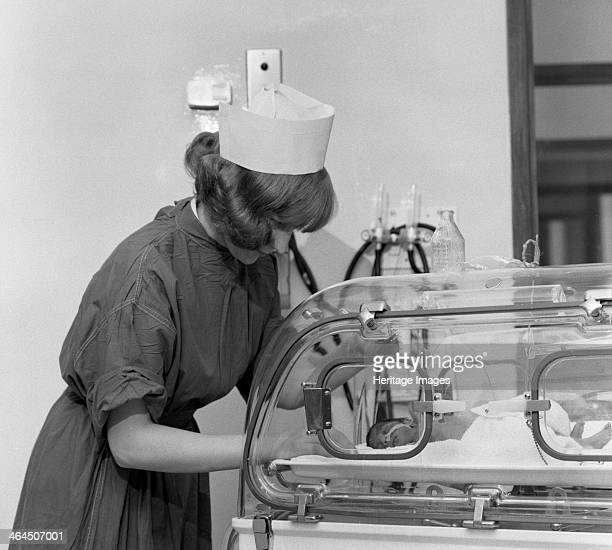 Special care unit for premature babies Nether Edge Hospital Sheffield South Yorkshire 1969 A nurse watches over a baby in an incubator Commisioned by...