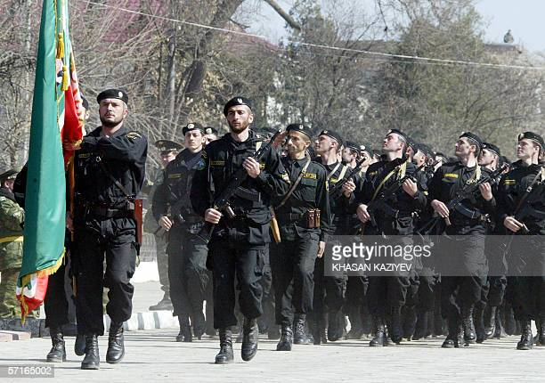 A special Chechen Interior Ministry unit parades 23 March 2006 on a street of the town of Gudermes to mark the third anniversary of the new Chechen...