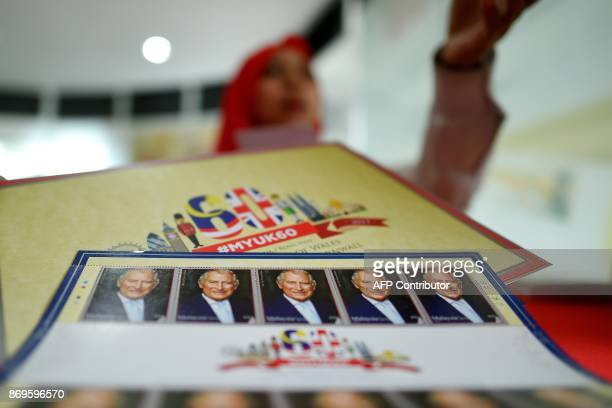 Special commemorative stamps to mark Britain's Prince Charles Prince of Wales and Camilla Duchess of Cornwall's visit to Malaysia are seen on a table...