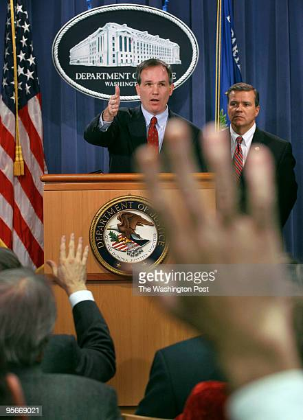 Special Counsel Patrick J. Fitzgerald, top left, and SAC Philadelphia Jack Eckenrode announce their grand jury findings at a press conference at the...