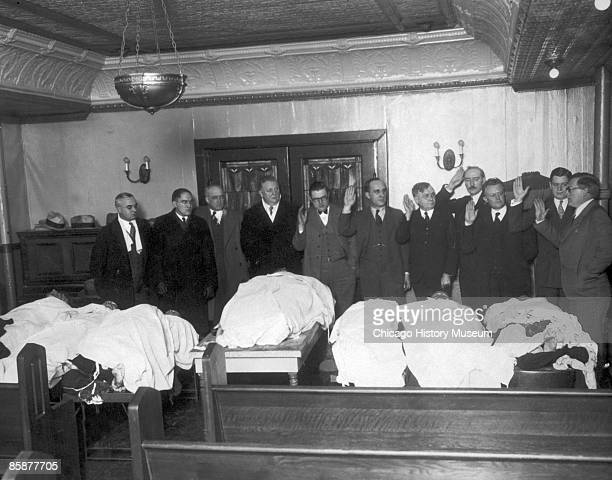 A special crime committee is sworn in over the bodies of the victims of the St Valentine's Day Massacre Chicago 1929 The killings spurred the...