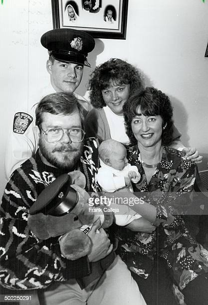 Special Delivery Little Jamie Dittburner rests comfortably in mom Margaret's arms oblivious to the uproar his sudden arrival sparked for dad Rick...