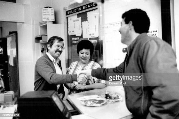 Special Delivery Postal employee Hank Makonieczny receiving a Christmas dinner *****of the Armadillo Restaurant and delivered by the restaurant's...