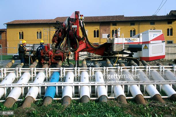 A special drill and giant drill bits wait to be used to make 41 holes or perforations into the earth on the north side of the Leaning Tower of Pisa...