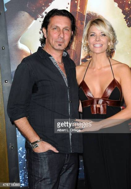 Special effect artist Patrick Tatopoulos and actress McKenzie Westmore arrive for the Premiere Of Warner Bros Pictures And Legendary Pictures' '300...