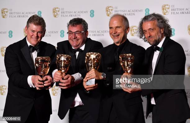 Special effects artists Richard R Hoover Gerd Nefzer John Nelson and Paul Lambert pose with the award for Special Visual Effects for their work on...