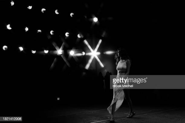 Special effects camera filter was used for this image.) A model walks the runway during the Rumer show during Afterpay Australian Fashion Week 2021...