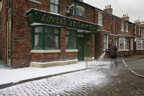 A special effects team covers the famous cobbles and terraced houses of television soap Coronation St in fake snow for the festive season for...