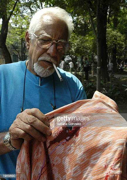Special effects technician Jesus Duval holds the shirt that actor Denzel Washington wore while filming a scene from the film Man On Fire while on...