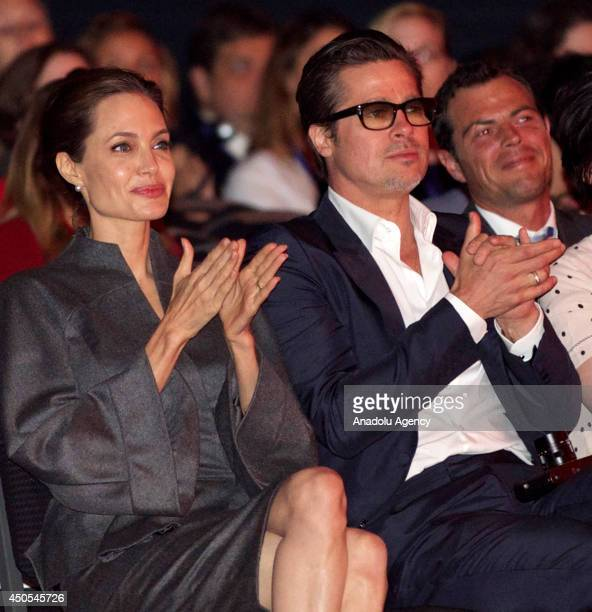 Special Envoy and actress Angelina Jolie actor Brad Pitt British Foreign Secretary William Hague and his wife Ffion Hague attend the Global Summit To...
