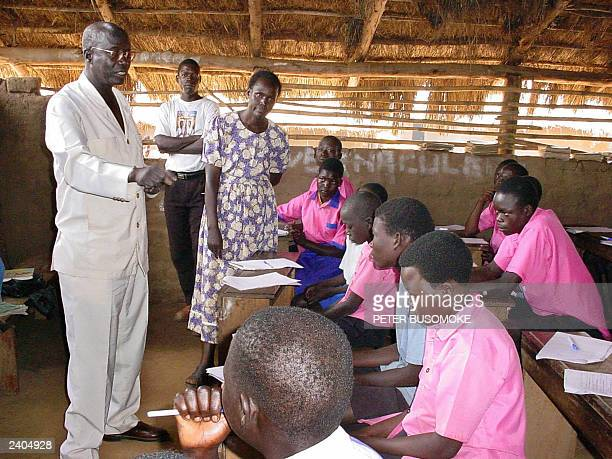 UN special envoy for Displaced Persons Francis Deng gives a speech 14 August 2003 in a school in Camp Awe west of Gulu town northern Uganda Deng...