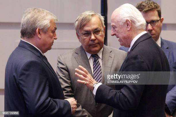 UN Special Envoy for Syria Staffan de Mistura and other attendees take part in the plenary session of Syria peace talks brokered by Iran Russia and...