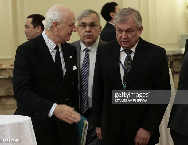 UN Special Envoy for Syria Staffan de Mistura speaks with Russia's chief negotiator for Syria Aleksandr Lavrentyev during the session of Syria peace...