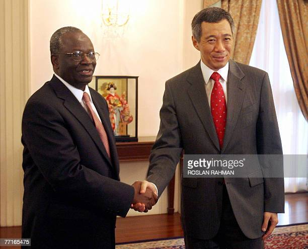 UN special envoy Ibrahim Gambari shakes hands with Singapore Prime Minister Lee Hsien Loong at the Istana presidential palace in Singapore 03 October...