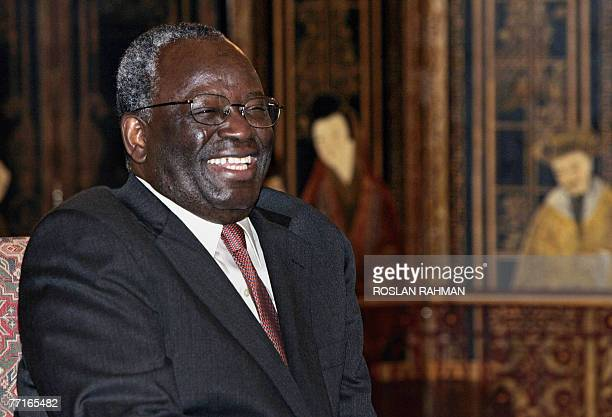 UN special envoy Ibrahim Gambari smiles during a call on Singapore Prime Minister Lee Hsien Loong at the Istana presidential palace in Singapore 03...