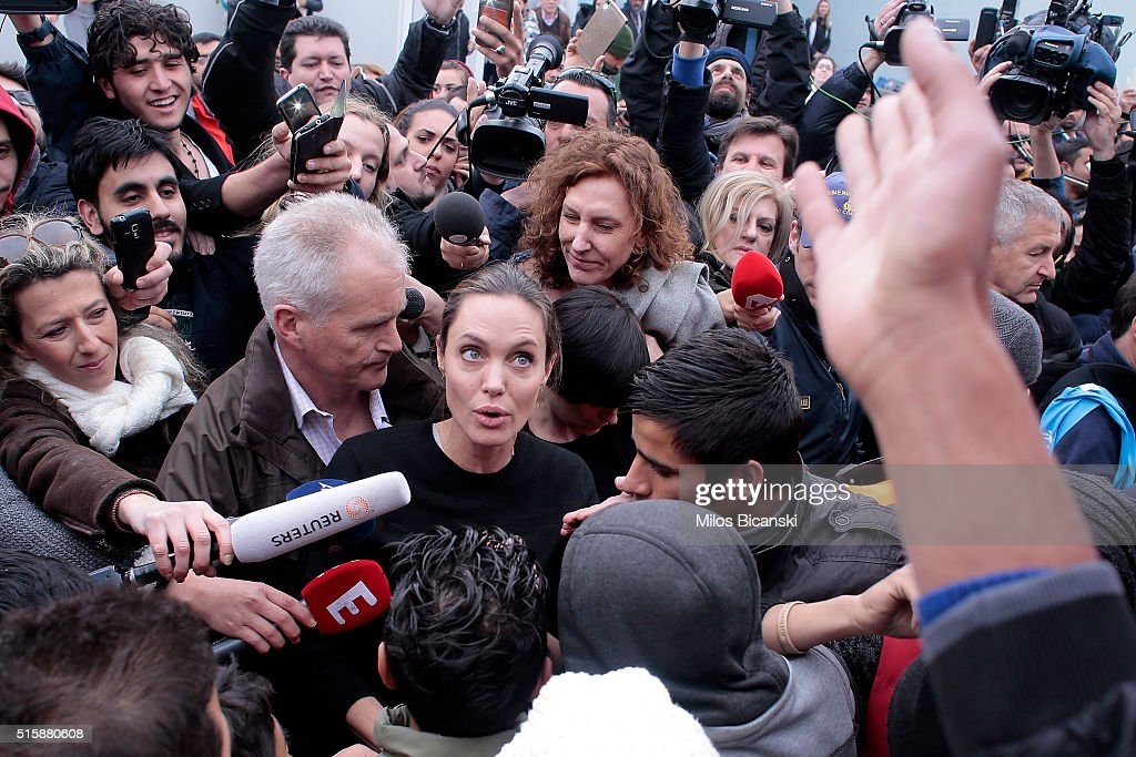 Special envoy of the United Nations High Commissioner for Refugees, Angelina Jolie talks to young migrants during her visit to the temporary refugee facilities at the port of Piraeus on March 16, 2016 in Athens, Greece.