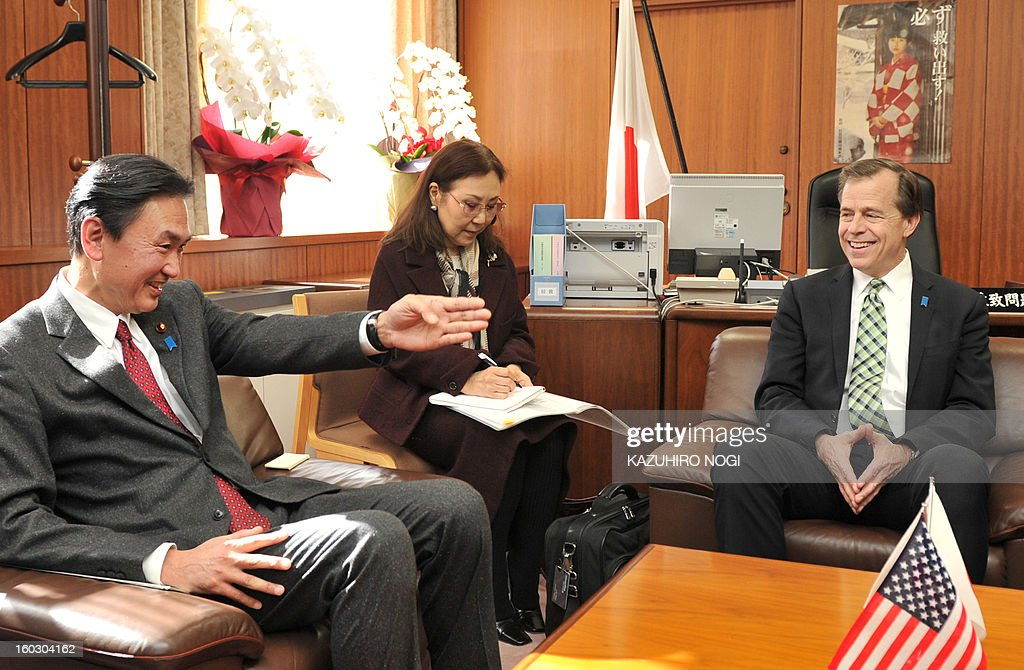 US special envoy on North Korea Glyn Davies (R) speaks with Keiji Furuya (L), state minister in charge of North Korea's abduction of Japanese citizens, at the latter's office in Tokyo on January 29...