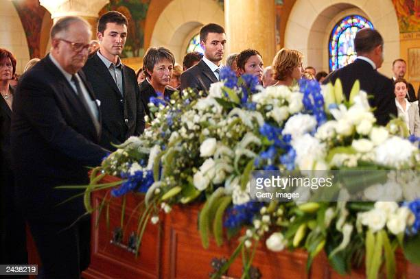 UN special envoy to Iraq Sergio Vieira de Mello's sons Laurent and Adrian de Mello and his wife Annie pay their respects during his funeral at Saint...
