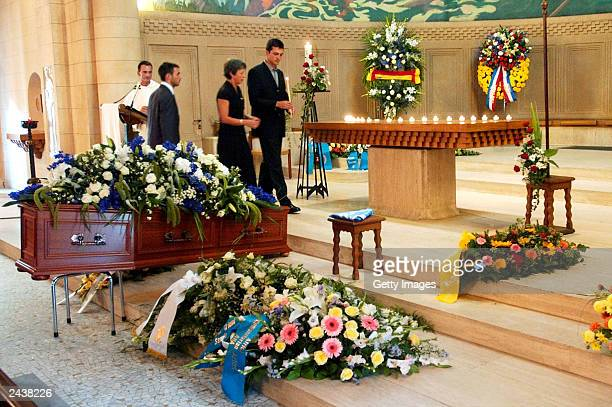 Special envoy to Iraq, Sergio Vieira de Mello's sons, Laurent and Adrian de Mello and his wife Annie light a candle during his funeral at Saint...
