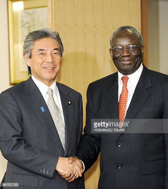 UN special envoy to Myanmar Ibrahim Gambari shakes hands with Japanese Foreign Minister Hirofumi Nakasone prior to their talks at Nakasone's office...