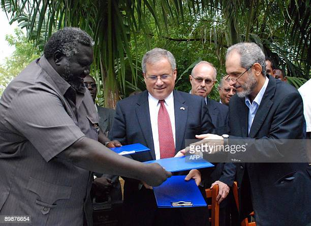 US Special Envoy to Sudan Scott Gration stands between with Malik Agar deputy chairman of the south�s ruling Sudan People�s Liberation Movement and...