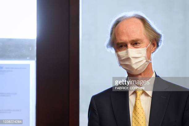 Special Envoy to Syria Geir Pedersen wearing a face mask, arrives for a press conference shortly prior to the resume UN-backed talks on a new...