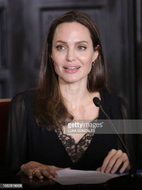 Special Envoy US actress Angelina Jolie speaks next to Peruvian Foreign Minister Nestor Popolizio during a press conference at the Government Palace...