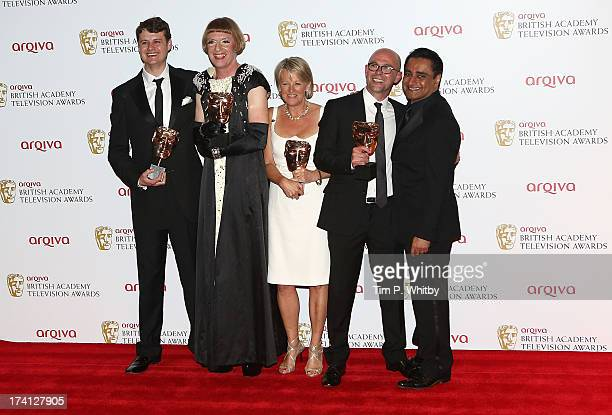 Special Factual Winners Joe Evans Grayson Perry Dina Lord and Neil Crombie pose in the press room at the Arqiva British Academy Television Awards...