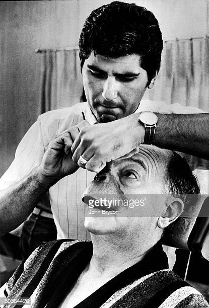 Special foamrubber makeup being applied to actor Maurice Evans' face for his role as the simian heavy in the motion picture Planet of the Apes