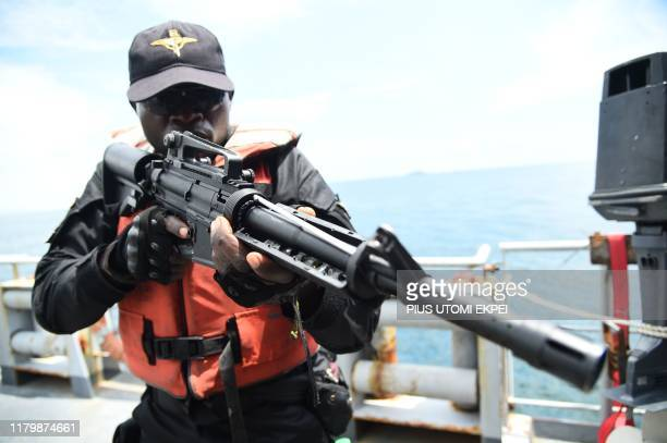 Special Force of the Nigerian navy tries to arrest pirates in F735 Germinal French Frigate in a stage managed operations during the five-day joint...