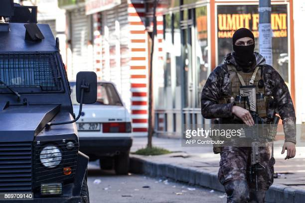 Special force police officer walks in the street on November 3, 2017 after clashes in the southeastern province of Diyarbakir. One Turkish police...