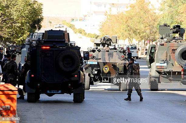 Special force police officers patrol at the explosion site on October 16 2016 near the Syrian border in Gaziantep after a bomber blew himself up A...